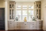 Full height glass-front kitchen cabinets