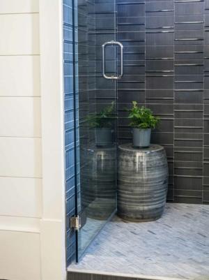 Tile shower with frameless glass door