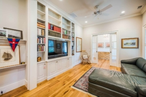 Den with built-in bookshelves and leather couch