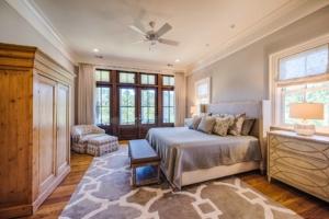 Master bedroom with reclaimed hardwood floor