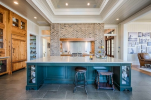 Kitchen with brick wall and large island