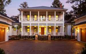 2-story house with two carriage houses