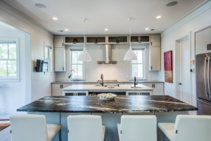 white kitchen with two islands