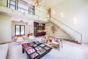living with floating glass staircase