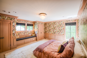 large bedroom with Gucci wallpaper