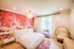 Bedroom with pink Gucci wallpaper