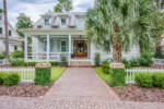 Two-story house with white picket fence