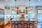 White kitchen with shiplap ceiling