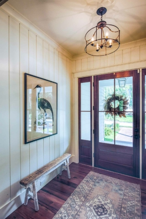 Front entry with vertical shiplap walls