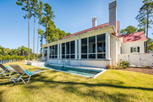 two-story house with screened back porch and a pool