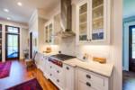 Kitchen with metal range hood