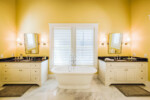 Master bathroom with freestanding tub and separate vanities