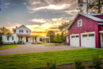 Two-story house with a red barn-style carriage house