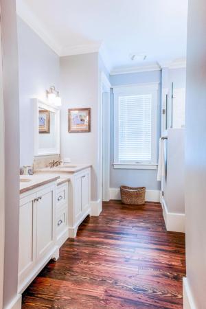 Master bathroom with heart pine flooring