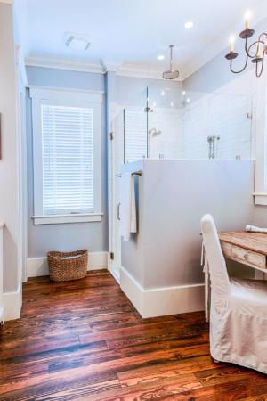 Master bathroom with reclaimed hardwood flooring