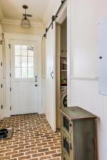 Mudroom with brick flooring