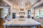 large kitchen island and white cabinets