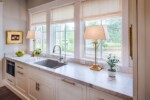 white kitchen cabinets with marble top