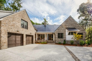 Two-story brick home with a standing seam metal roof