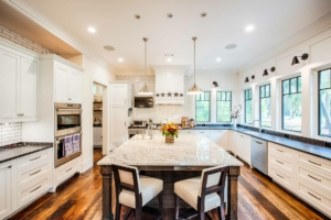 Kitchen with white cabinets and subway tile