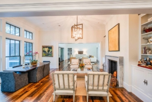 Dining/sitting room with a cast stone fireplace surround