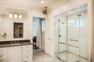 Master shower with basketweave tile floor