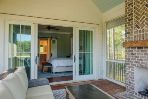 Screened master porch with outdoor fireplace