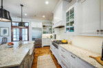 White kitchen with gray island
