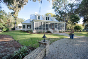 White two-story house with screened back porch