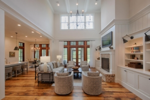 Living room with vaulted ceiling and brick fireplace