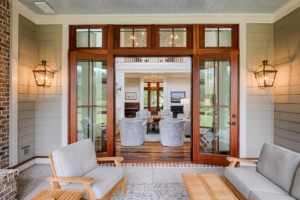 Mahogany double doors leading from porch to living room