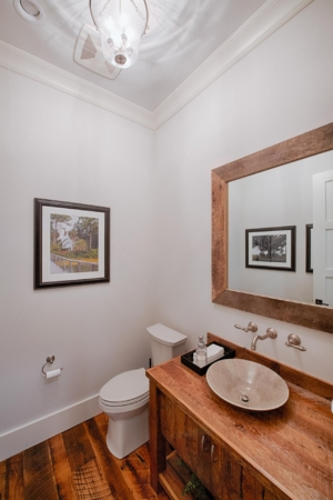 Powder room with vessel sink and wall mounted fixtures