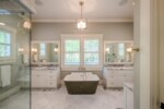 Master bathroom with marble floors and countertops