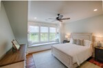 Bedroom with built-in window bench seat
