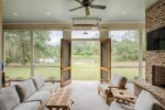 Screened back porch with outdoor fireplace