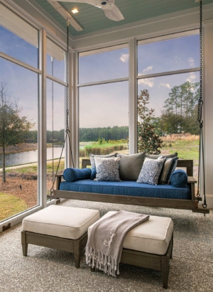 Screened porch with bed swing