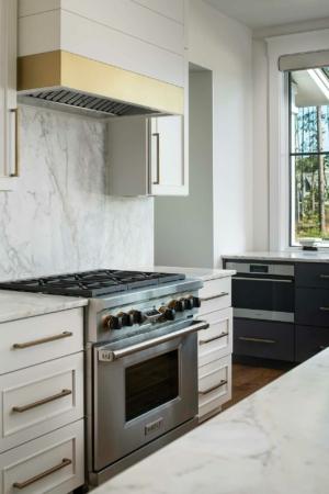 Kitchen with Wolf range and marble backsplash