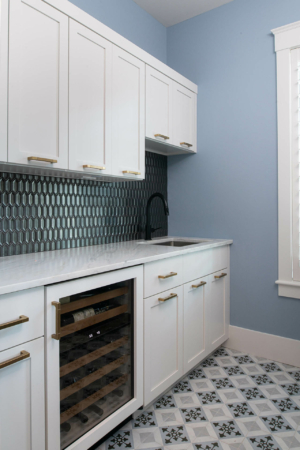 Laundry/mud room with extra storage and wine refrigerator