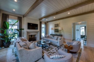 Living room with shiplap walls and ceiling