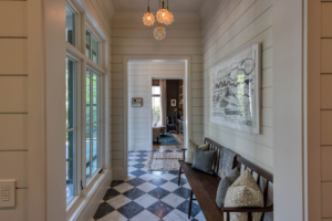 Foyer with checkerboard marble flooring