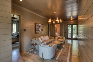 Sitting room with shiplap walls and ceiling