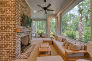Screened porch with brick fireplace