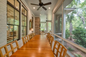 Screened porch with dining table