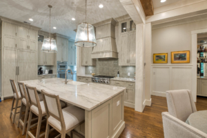 Kitchen with large island and gray cabinets