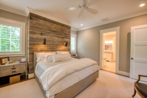 Master bedroom with reclaimed wood accent wall