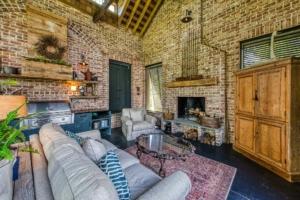 Carolina room with brick walls and exposed ceiling beams