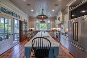 Kitchen with v-groove ceiling and reclaimed heart pine flooring