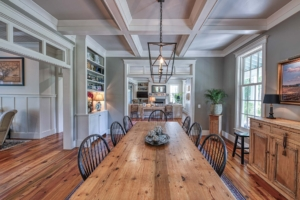 Dining room with coffered ceiling and reclaimed heart pine flooring