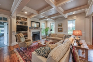 Living room with coffered ceiling and hardwood floor