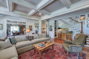 Living room with coffered ceiling and reclaimed heart pine flooring